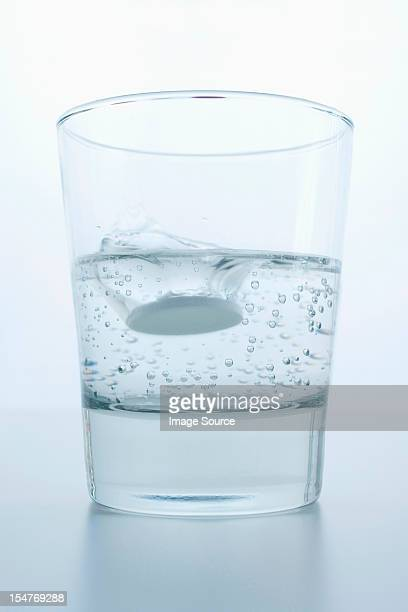 Pill in glass of water