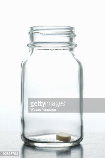 Pill in jar : Stock Photo