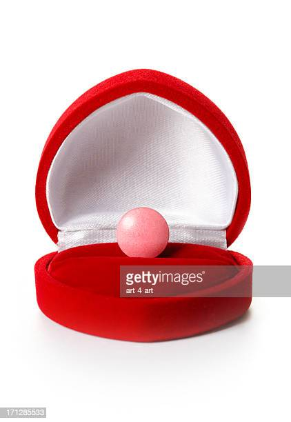 Pill in open red jewelry box