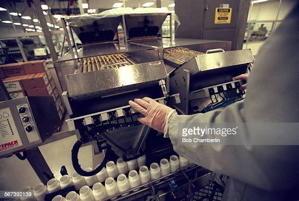 Pill loading machine whre vitamin E pills go into bottles at Leiner Health Care Products the world s largest manufacture of vitamins and supplements...