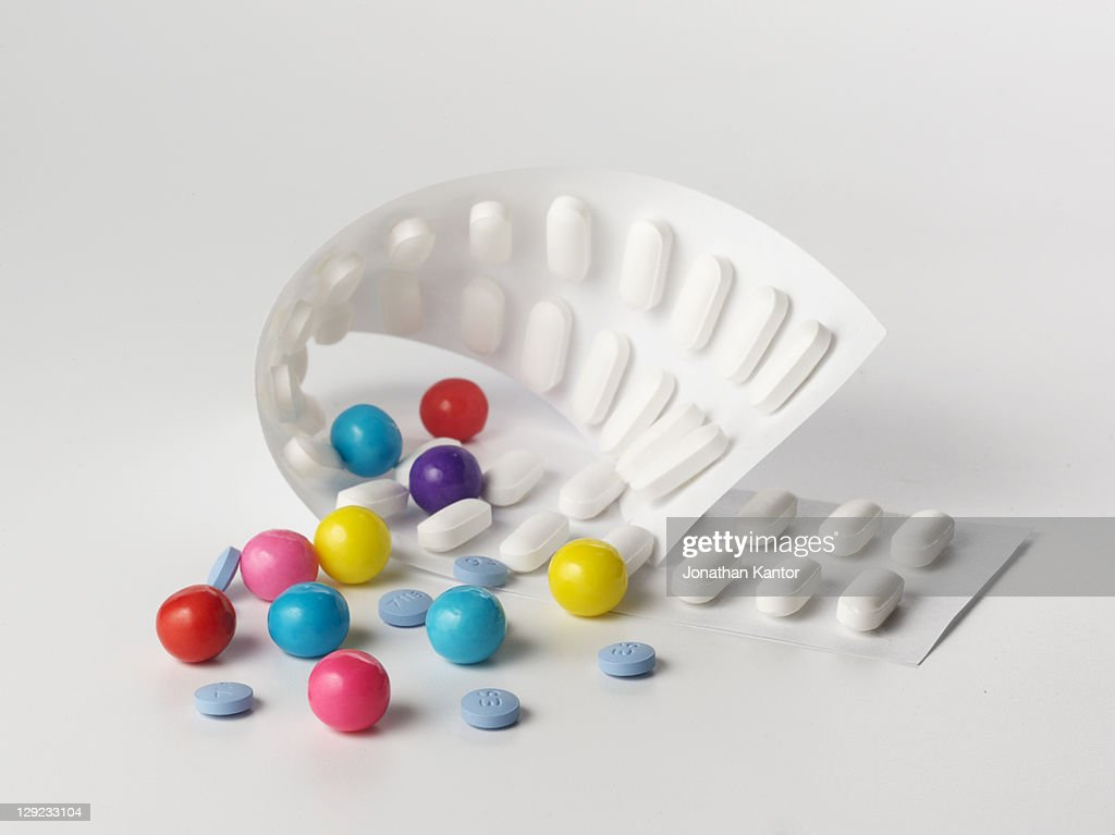 Pill popping like candy : Stock Photo