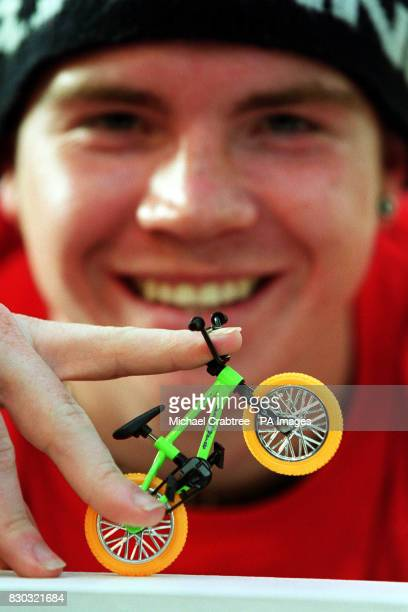 Pill UK King of Concrete Champion Freestyle BMX tries out a Flix Trix a scaled down version of a real BMX bicycle at the British International Toy...