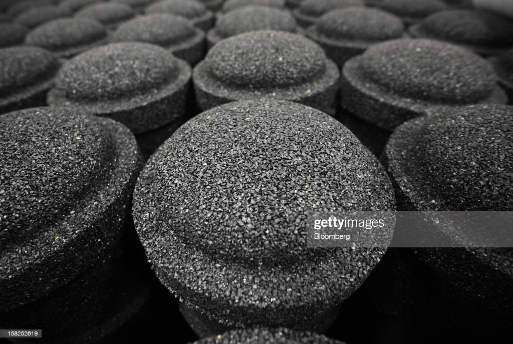 Pillars of pure recycled rubber grains are seen during processing at Tigar AD rubber factory in Pirot, Serbia, on Tuesday, Dec. 11, 2012. The Serbia-based company in 2008 acquired the Century Division of Hunter Boot Ltd. and specializes in safety boots. Photographer: Oliver Bunic/Bloomberg via Getty Images