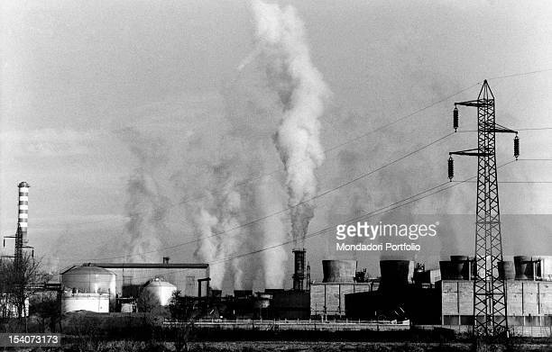 Pillars of smoke getting out of the chimneys of the Italian chemical plant Sisal Limito di Pioltello 1970s