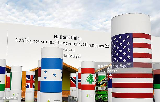 Pillars with the names and national flags of countries attending the COP 21 UN climate conference decorate the outside of the venue hall on November...