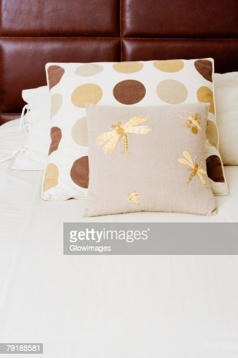 Pillow and cushions on the bed : Foto de stock