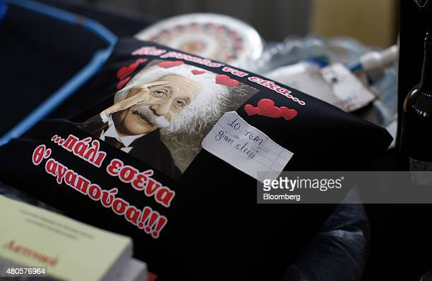 A pillow with an image of Albert Einstein sits for sale for 10 TEM at an indoor market where an informal barter currency called TEM is used to...