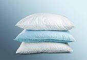White Pillows Pile on grey background