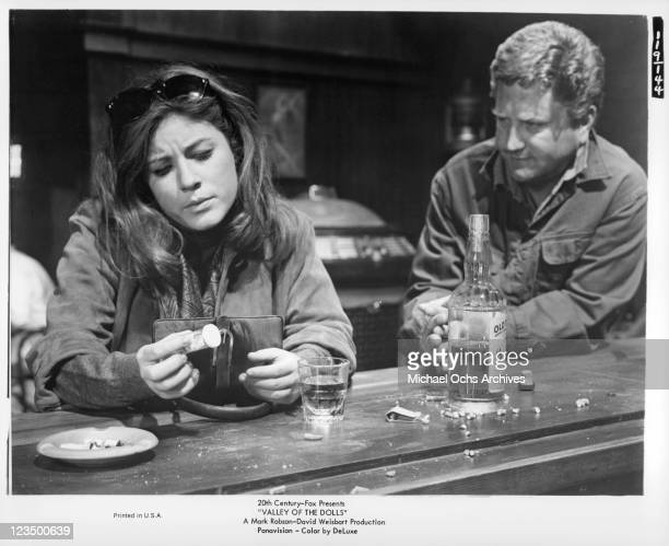 Pills and booze are the center of Patty Duke's attention despite Barry Cahill's attention in a scene from the film 'Valley Of The Dolls' 1967