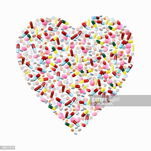 Pills and capsules in heart shape.
