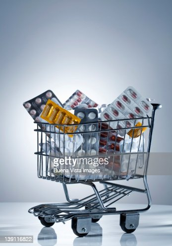 pills in a shopping cart : Stock Photo