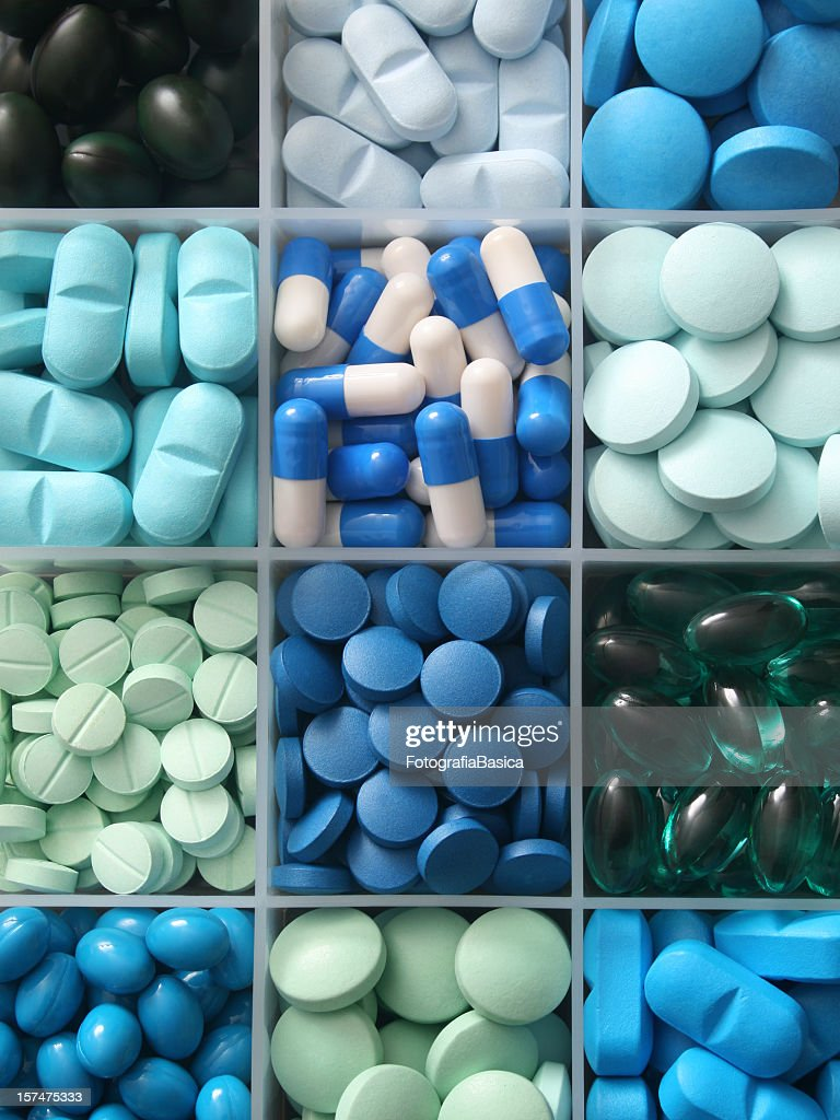 Pills in container : Stock Photo
