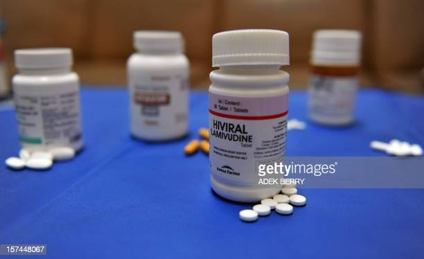 Pills of antiretroviral medicine are dislayed at a government hospital specilizing in HIV/AIDS one day before World Aids Day in Jakarta on November...