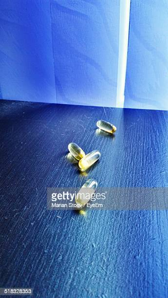 Pills On Blue Wooden Table