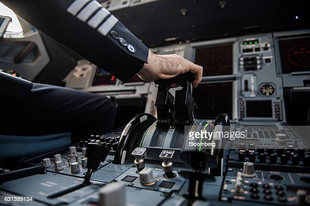 A pilot adjusts flight controls inside the cockpit onboard a passenger aircraft operated by Wizz Air Holdings Plc at Liszt Ferenc airport in Budapest...