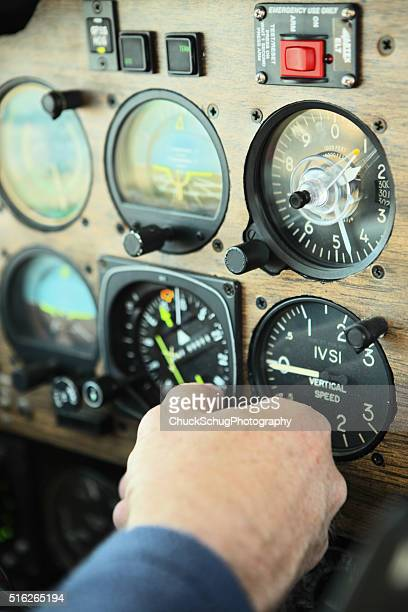 Pilot Adusts Airplane Cockpit Dashboard