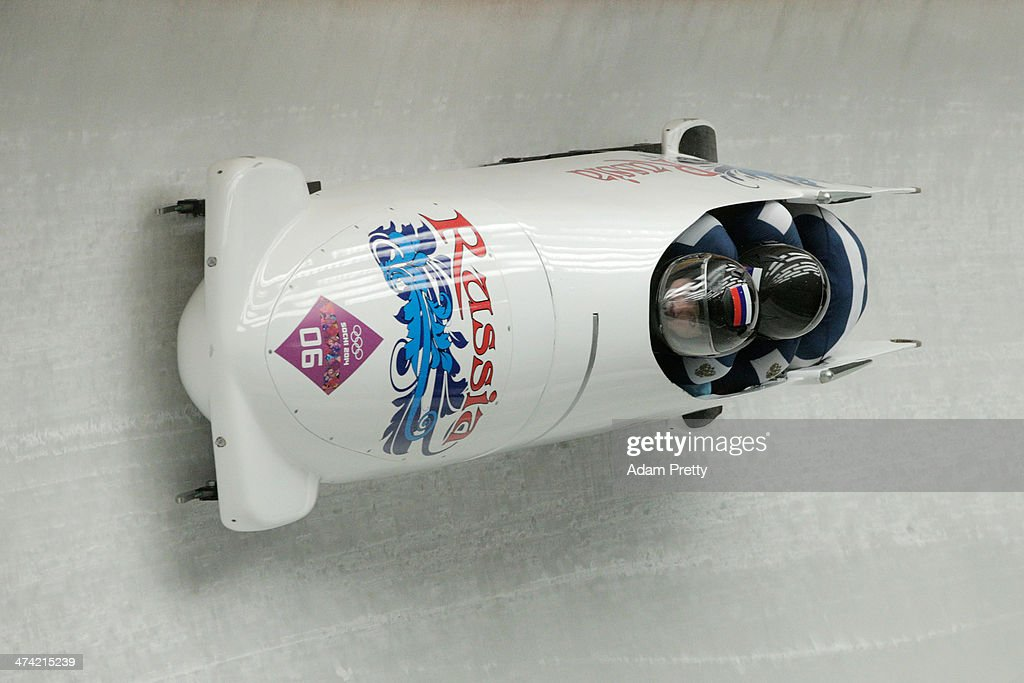 Pilot Alexander Kasjanov, Ilvir Huzin, Maxim Belugin and Aleksei Pushkarev of Russia team 2 make a run during the Men's Four Man Bobsleigh heats on Day 15 of the Sochi 2014 Winter Olympics at Sliding Center Sanki on February 22, 2014 in Sochi, Russia.