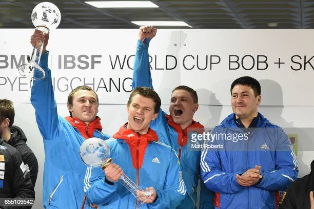 Pilot Alexander Kasjanov of Russia celebrates on the podium with Aleksei Pushkarev Vasiliy Konsratenko and Alexey Zaitsev after the 4man Bobsleigh...