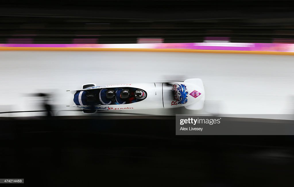 Pilot Alexander Zubkov, Alexey Negodaylo, Dmitry Trunenkov and Alexey Voevoda of Russia team 1 make a run during the Men's Four Man Bobsleigh heats on Day 15 of the Sochi 2014 Winter Olympics at Sliding Center Sanki on February 22, 2014 in Sochi, Russia.