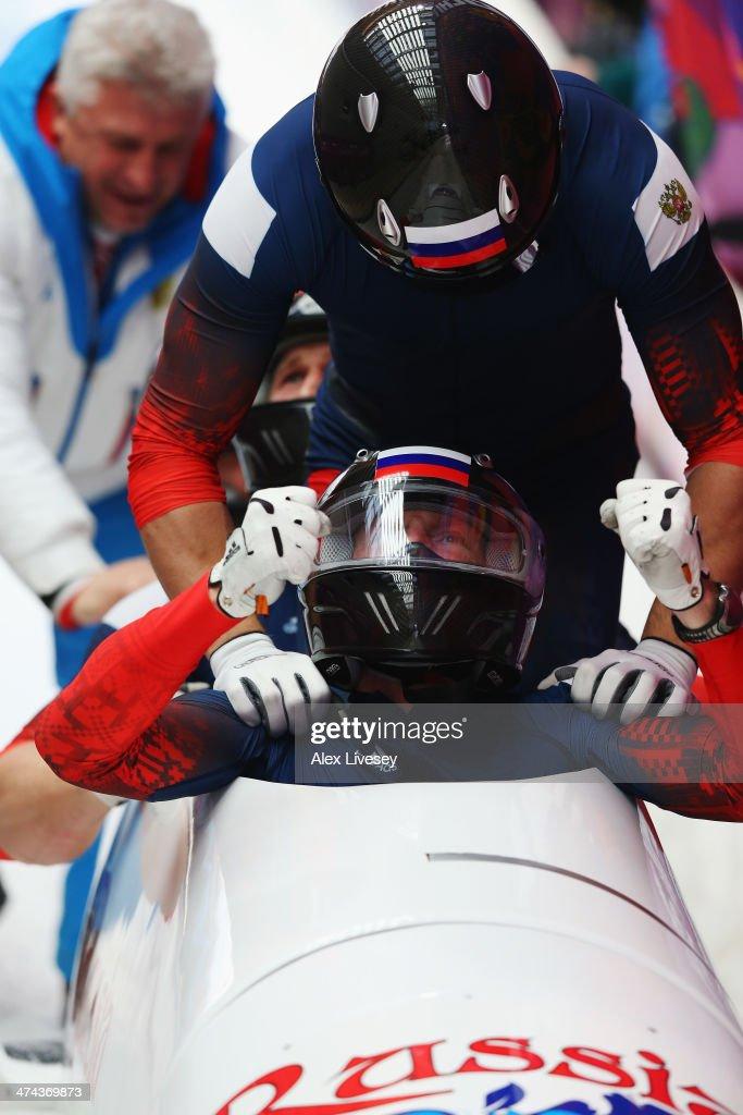 Pilot Alexander Zubkov Alexey Negodaylo Dmitry Trunenkov and Alexey Voevoda of Russia team 1 celebrate winning the gold medal during the Men's...