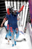 Pilot Alexander Zubkov and Alexey Voevoda of Russia team 1 celebrate as they win the gold medal during the Men's TwoMan Bobsleigh on Day 10 of the...