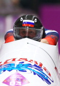 Pilot Alexander Zubkov and Alexey Voevoda of Russia team 1 make a run during the Men's TwoMan Bobsleigh heats on Day 9 of the Sochi 2014 Winter...