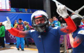 Pilot Alexander Zubkov of Russia team 1 celebrates winning gold during the Men's TwoMan Bobsleigh on Day 10 of the Sochi 2014 Winter Olympics at...