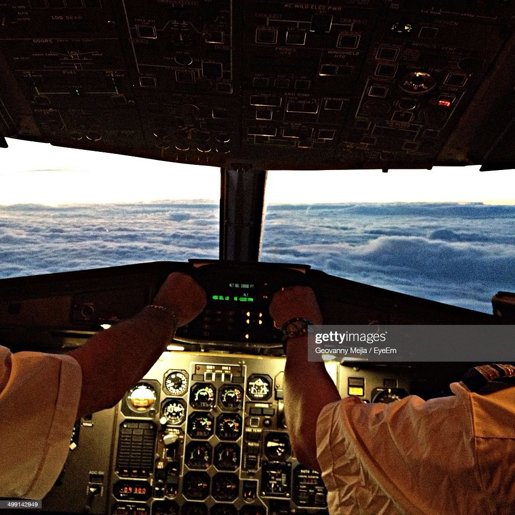 Pilot and co-pilot in airplane cockpit