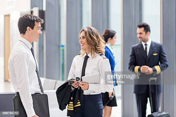 Pilot and flight attendants talking in the airport