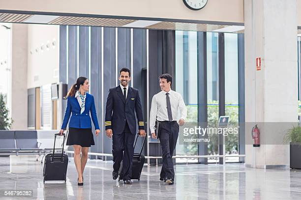Pilot and flight attendants walking at the airport