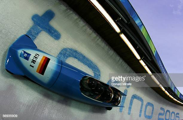 Pilot Andre Lange and teammates Rene Hoppe Kevin Kuske and Martin Putze of Germany 1 start their run in the Four Man Bobsleigh Final on Day 15 of the...
