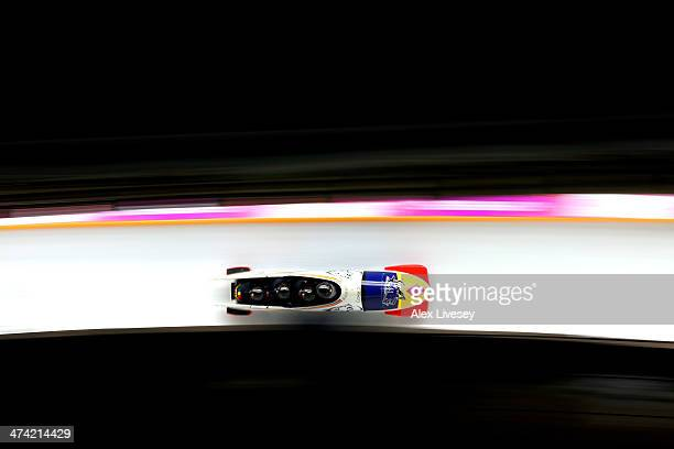 Pilot Andreas Neagu Florin Craciun Paul Muntean and Danut Moldovan of Romania team 1 make a run during the Men's Four Man Bobsleigh heats on Day 15...