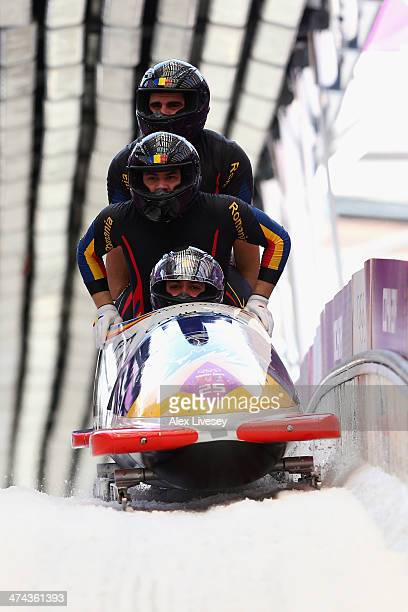 Pilot Andreas Neagu Florin Craciun Paul Muntean and Danut Moldovan of Romania team 1 finish a run during the Men's FourMan Bobsleigh on Day 16 of the...