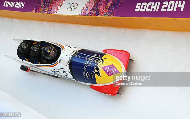 Pilot Andreas Neagu Florin Craciun Paul Muntean and Danut Moldovan of Romania team 1 make a run during the Men's FourMan Bobsleigh on Day 16 of the...