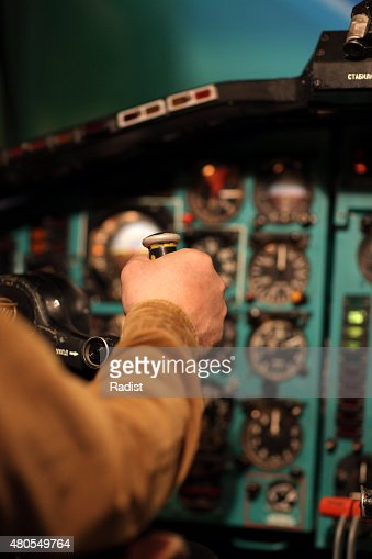 Pilot aviates by control column : Stock Photo
