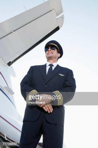 Pilot Beside an Airplane : Stock Photo