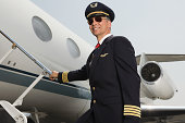 Pilot boarding airplane