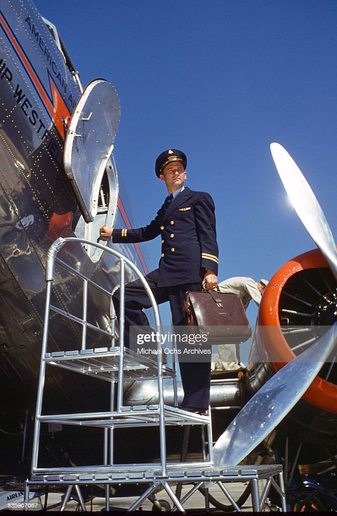 A pilot boards a Convair Liner for American Airlines.