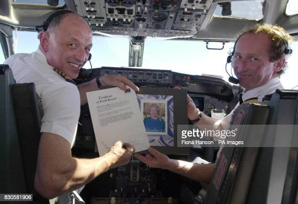 Pilot Captain Bob Wilson and First Officer Vince Powell of Flight BA who carried a record breaking stamp celebrating the 75th birthday of Queen...