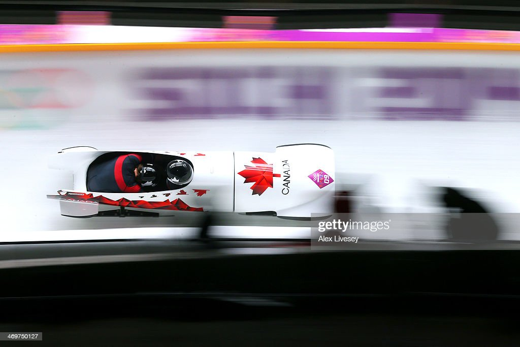 Pilot Chris Spring and Jesse Lumsden of Canada team 2 make a run during the Men's TwoMan Bobsleigh heats on Day 9 of the Sochi 2014 Winter Olympics...