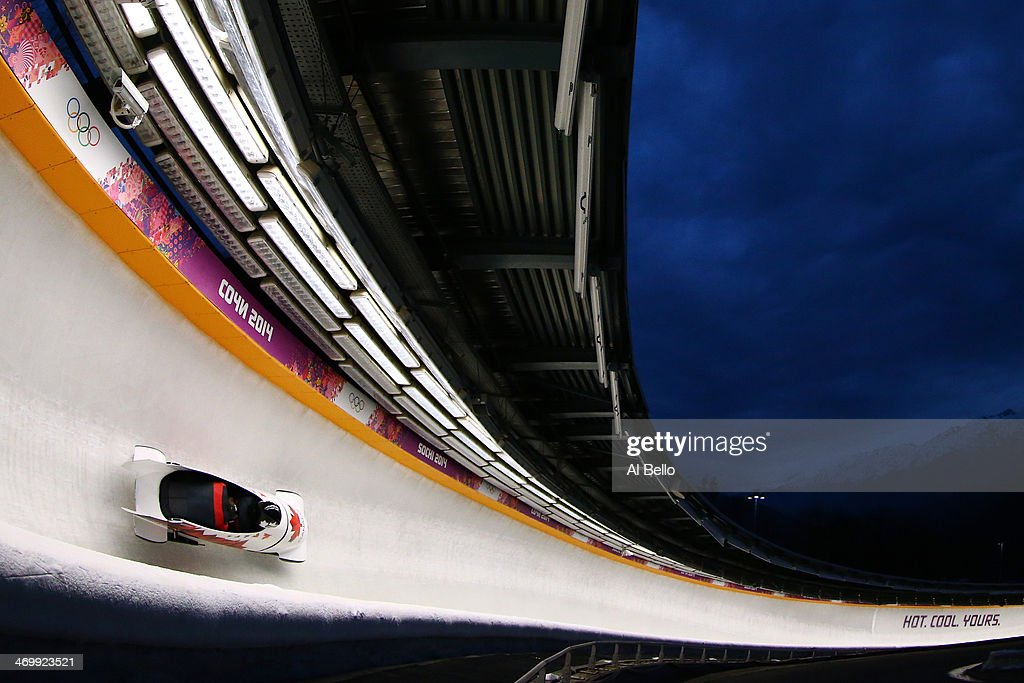 Pilot Chris Spring and Jesse Lumsden of Canada team 2 make a run during the Men's TwoMan Bobsleigh on Day 10 of the Sochi 2014 Winter Olympics at...