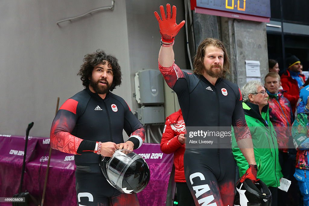 pilot Chris Spring and Jesse Lumsden of Canada team 2 wave to the crowd during the Men's TwoMan Bobsleigh on Day 10 of the Sochi 2014 Winter Olympics...