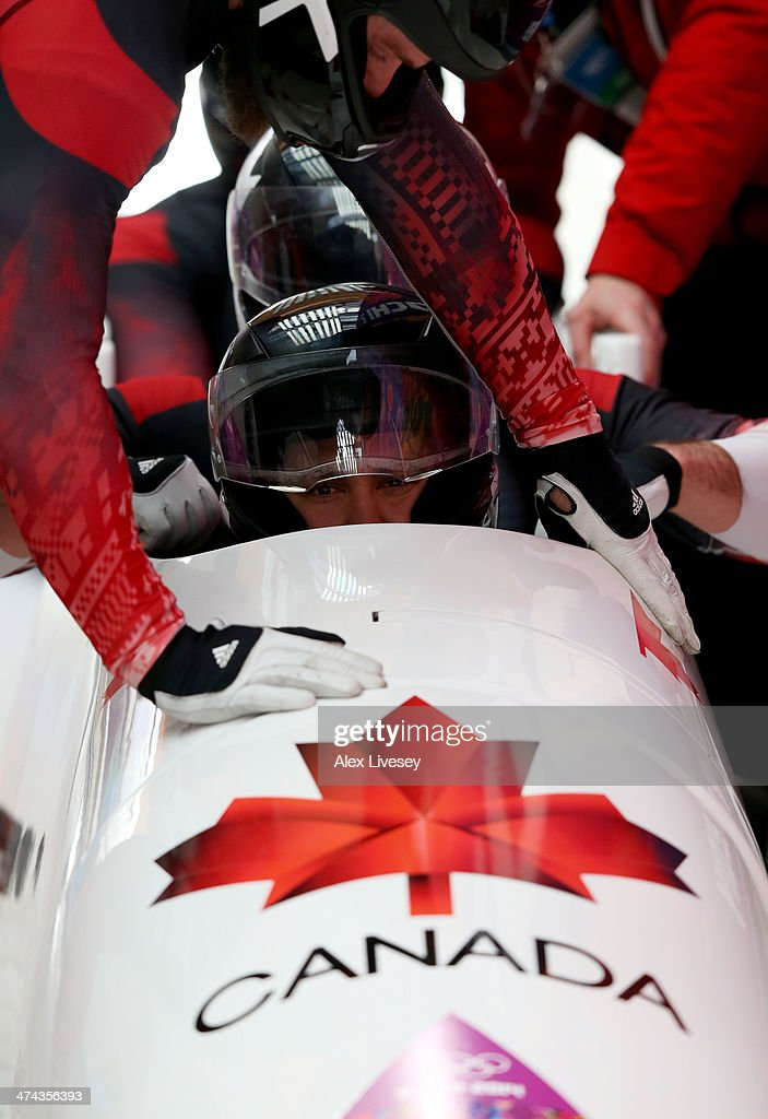 Pilot Chris Spring of Canada team 1 looks on after a run during the Men's FourMan Bobsleigh on Day 16 of the Sochi 2014 Winter Olympics at Sliding...