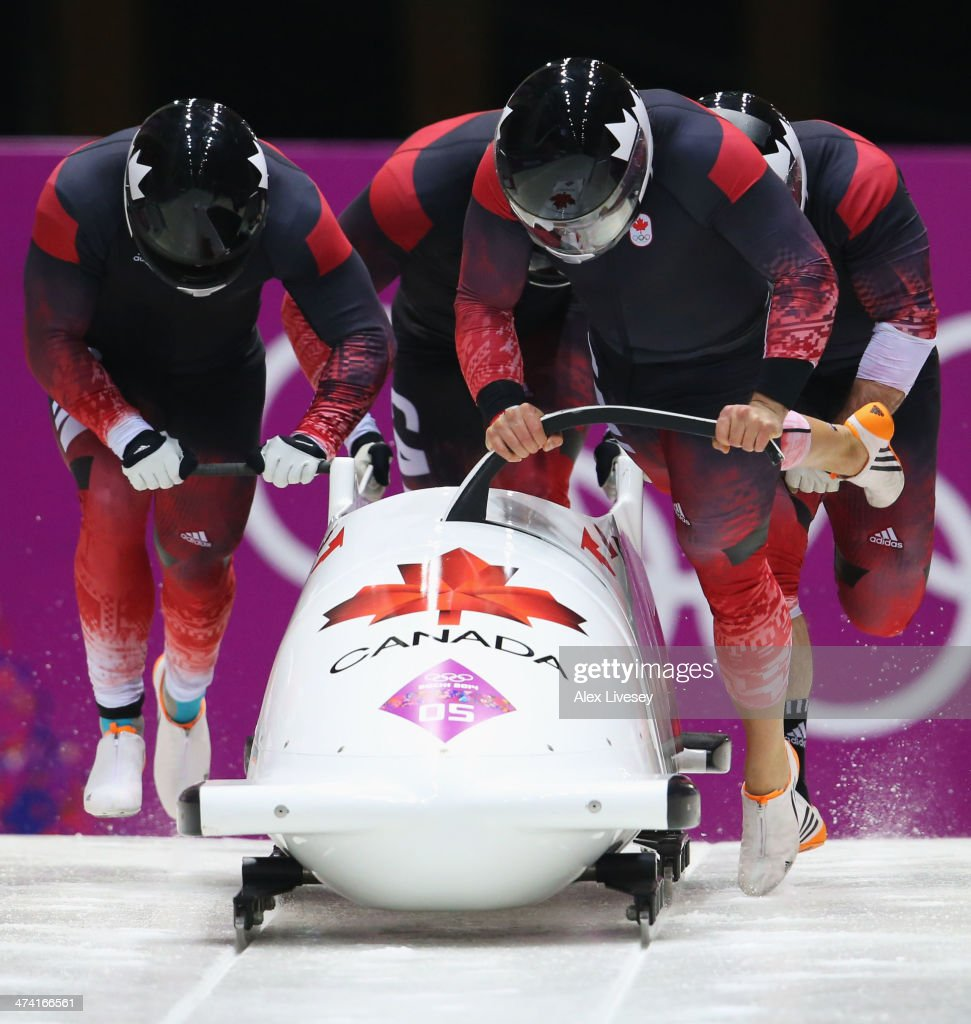 Pilot Chris Spring Timothy Randall James McNaughton and Bryan Barnett of Canada team 1 during the Men's Four Man Bobsleigh heats on Day 15 of the...