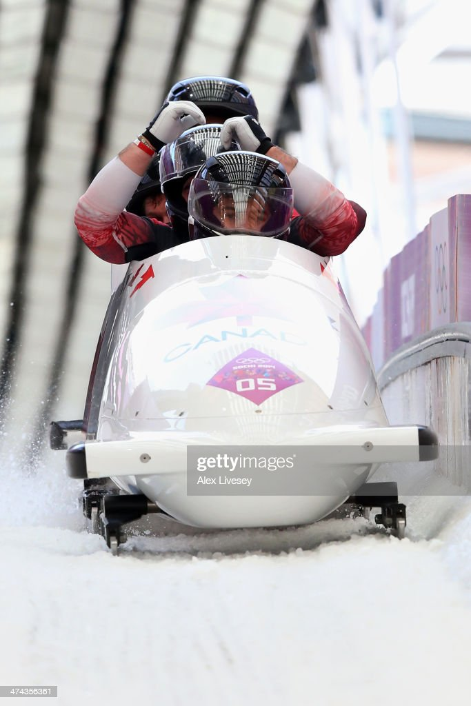 Pilot Chris Spring Timothy Randall James McNaughton and Bryan Barnett of Canada team 1 finish a run during the Men's FourMan Bobsleigh on Day 16 of...