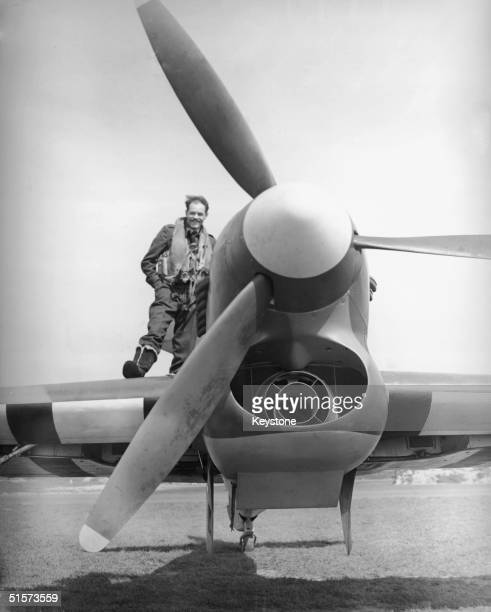 A pilot clambers into the cockpit of his new Hawker Typhoon fighter plane April 1943