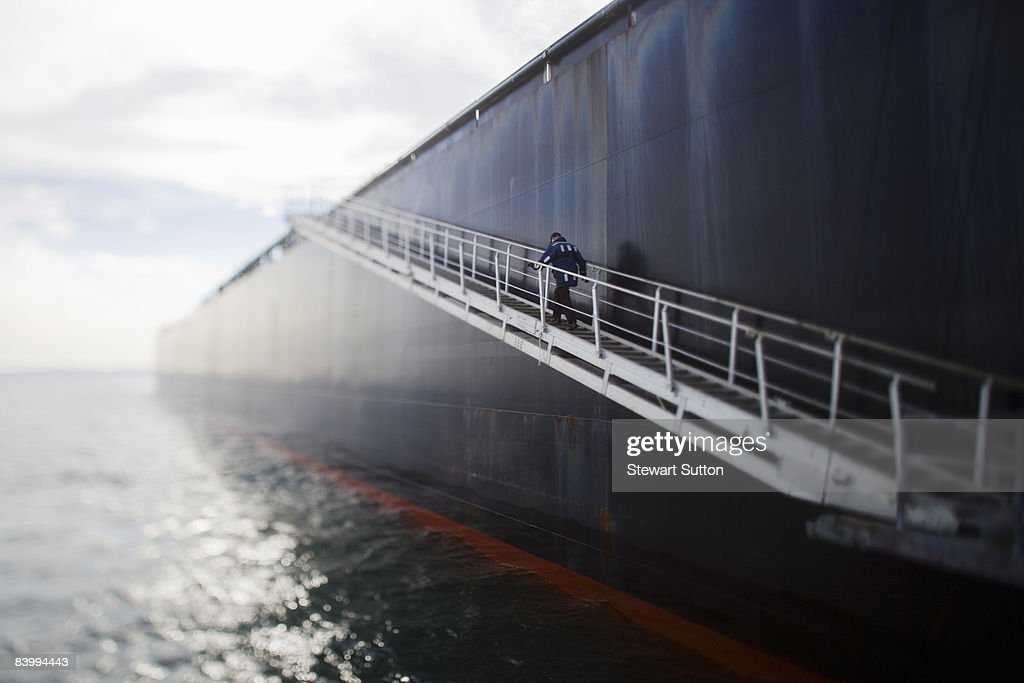 Pilot climbing stairs on oil tanker. : Stock Photo