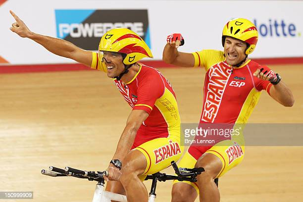 Pilot Diego Javier Munoz and Miguel Angel Clemente Solano of Spain celebrate winning bronze in the Men's Individual B Pursuit on day 1 of the London...