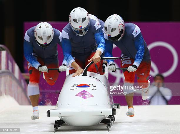 Pilot Donghyun Kim Sik Kim Kyunghyun Kim and Jeahan Oh of Korea team 2 make a run during the Men's Four Man Bobsleigh heats on Day 15 of the Sochi...