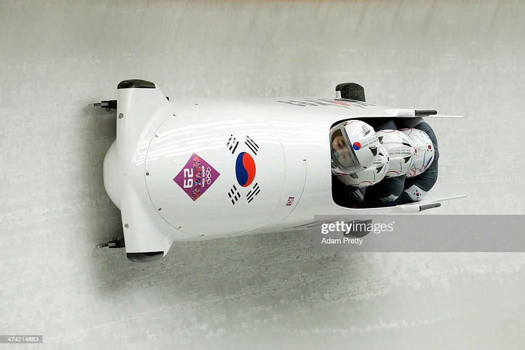 Pilot Donghyun Kim, Sik Kim, Kyunghyun Kim and Jeahan Oh of Korea team 2 make a run during the Men's Four Man Bobsleigh heats on Day 15 of the Sochi 2014 Winter Olympics at Sliding Center Sanki on February 22, 2014 in Sochi, Russia.